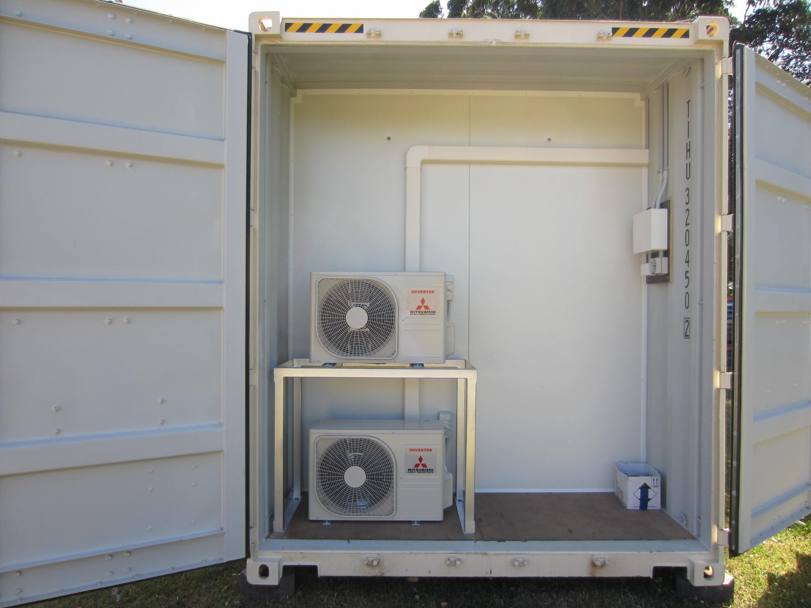 20' as new container modified into a 2 room unit with full electrical fit out, ACs, glass sliding doors and small storeroom behind container doors.