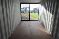 20' container modified with a glass sliding door and glass window