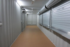 40' as new high cube container modified with 4x roller doors, benches under the three serving roller doors, 1x PA door, laundry tub, pressure pump, vinyl floor coverings and electrical fit out.
