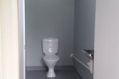 20' as new container modified into 3 toilet cubicles; disabled, ambulant and standard with a storeroom behind the container doors