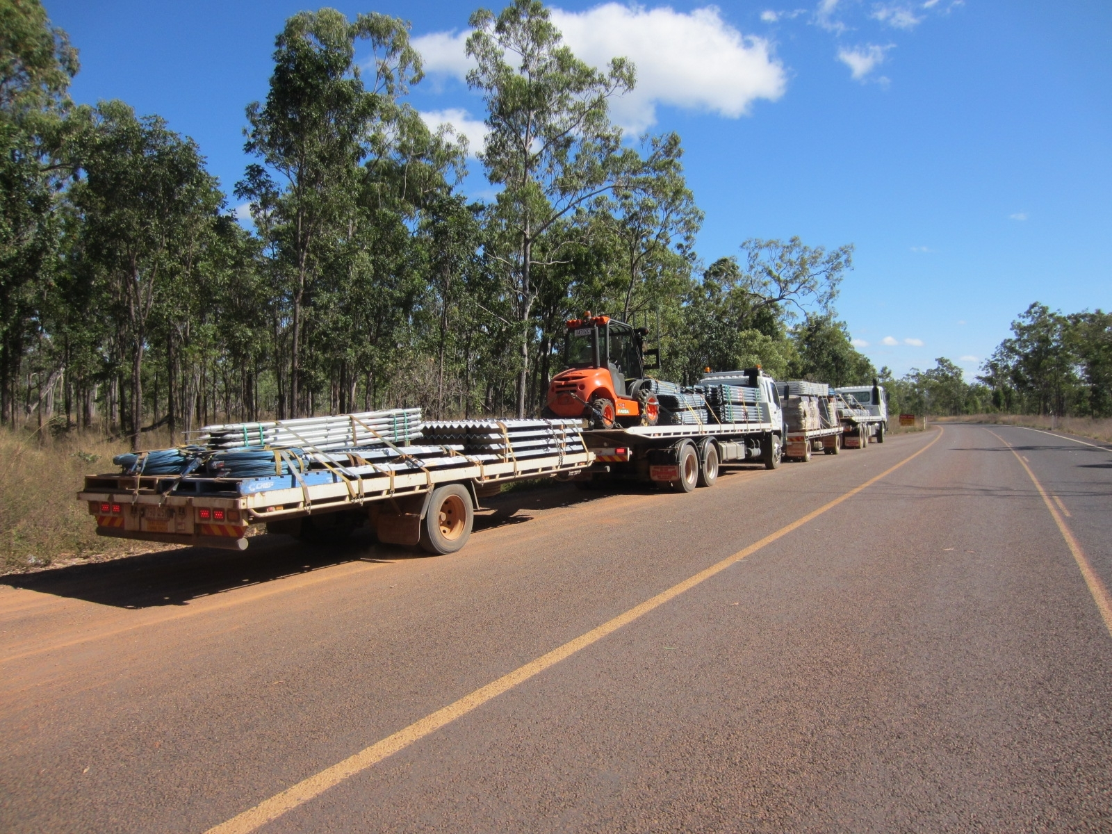 Cape York fencing materials; use of our forkift to load and unload